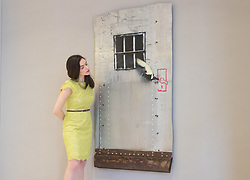 Bonhams, London, March 6th 2017. Fine art auctioneers Bonhams hold a preview in London  for their upcoming Post-War and Contemporary Art Sale which takes place on March 8th 2017. PICTURED: A woman examines Banksy's 'Jailbreak' valued at £100,000 - £150,000.