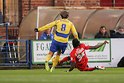 York City defender, on loan from Arsenal, Stefan OConnor tackles Accrington Stanley midfielder Josh Windass  during the Sky Bet League 2 match between York City and Accrington Stanley at Bootham Crescent, York, England on 28 November 2015. Photo by Simon Davies.