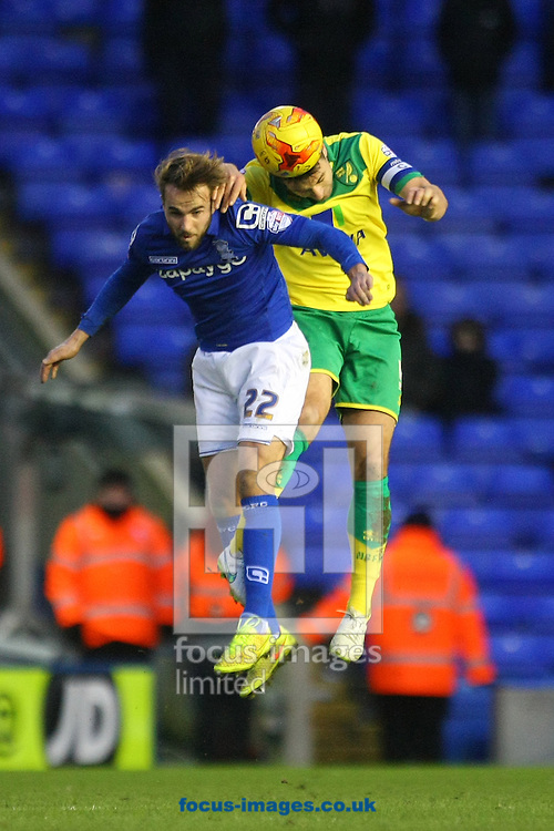 Andrew&nbsp;Shinnie of Birmingham and Russell Martin of Norwich in action during the Sky Bet Championship match at St Andrews, Birmingham<br /> Picture by Paul Chesterton/Focus Images Ltd +44 7904 640267<br /> 31/01/2015