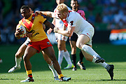 Stargroth Amean of Papua New Guinea gets tackled by James Graham of England during the Rugby League World Cup Quarter-Final match between England and  Papua New Guinea at Melbourne Rectangular Stadium, Melbourne, Australia on 19 November 2017. Photo by Mark  Witte.
