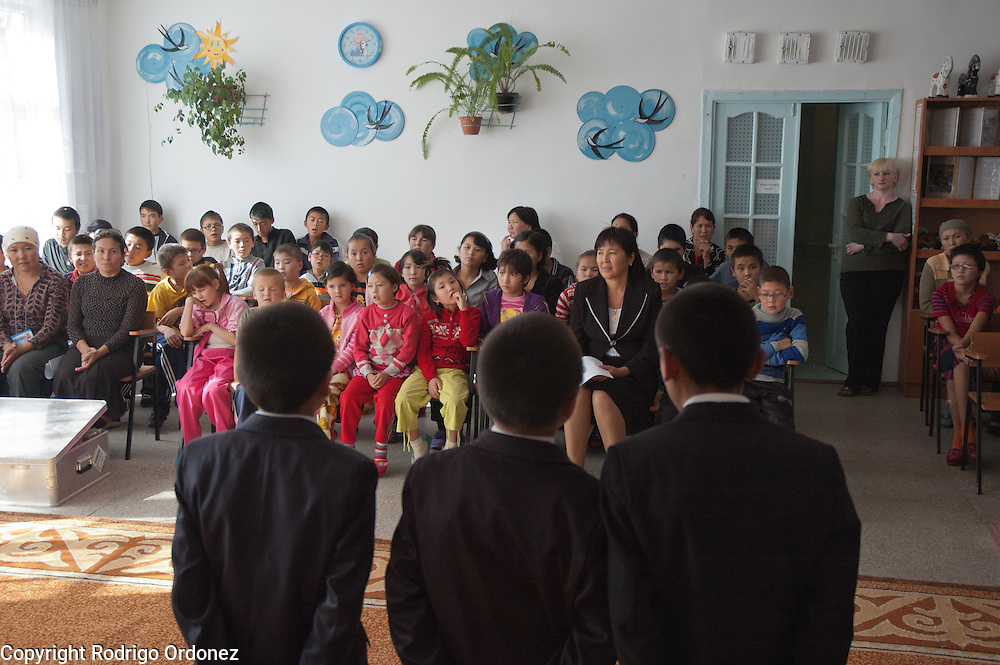 Three boys sing a song for their schoolmates during the opening ceremony of a child-friendly space supported by Save the Children at Secondary School for the Blind, in Osh (Kyrgyzstan). At this boarding school, children with and without impaired vision study together.