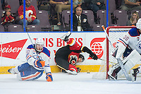 PENTICTON, CANADA - SEPTEMBER 17: Ryan Lomberg #56 of Calgary Flames slides into the boards behind the net against the Edmonton Oilers on September 17, 2016 at the South Okanagan Event Centre in Penticton, British Columbia, Canada.  (Photo by Marissa Baecker/Shoot the Breeze)  *** Local Caption *** Ryan Lomberg;