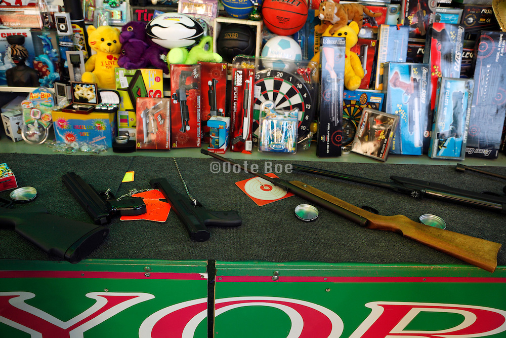 various pistols and air guns at a fairground shooting stand France