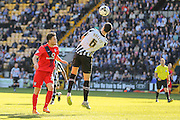 Notts County defender Haydn Hollis heads away from York City forward Reece Thompson during the Sky Bet League 2 match between Notts County and York City at Meadow Lane, Nottingham, England on 26 September 2015. Photo by Simon Davies.