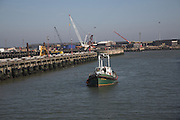 Boat entering docks, Lowestoft, Suffolk, England