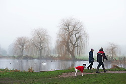 ©Licensed to London News Pictures 01/01/2020<br /> Sidcup ,UK. A couple walk along the River Cray with their dog. New years day foggy weather at Footscray Meadows in Sidcup, South East London this morning.Photo credit: Grant Falvey/LNP