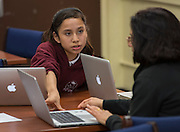 Students show teachers innovative ways to use technology during an after-school session at Young Women's College Preparatory Academy, March 10, 2014.