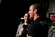 Baltimore, Maryland - May 17, 2018: Jason Zone Fisher, pit reporter for the World Armwrestling League, holding a Bleacher Report Live branded microphone, interviews middleweight Jordan Sill after his win during the World Armwrestling League Supermatch Showdown Series at Rams Head Live in Baltimore, Thursday May 17th, 2018. Bleacher Report Live is the exclusive broadcaster of the event. With the recent advent of online video streaming services, niche sporting leagues are now able to sign broadcast deals. <br /> <br /> <br /> CREDIT: Matt Roth for The New York Times<br /> Assignment ID: 30219819A