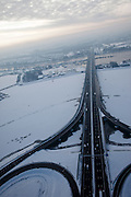 Nederland, Amsterdam, Zeeburg, 07-01-2010; Zeeburger eiland met ringweg A10 in de sneeuw, afslag IJburg en centrum. Op het tweede plan water van het Nieuwe Diep..Zeeburger island and ring road A10 in the snow. Second plan the water van het Nieuwe Diep..luchtfoto (toeslag), aerial photo (additional fee required).foto/photo Siebe Swart