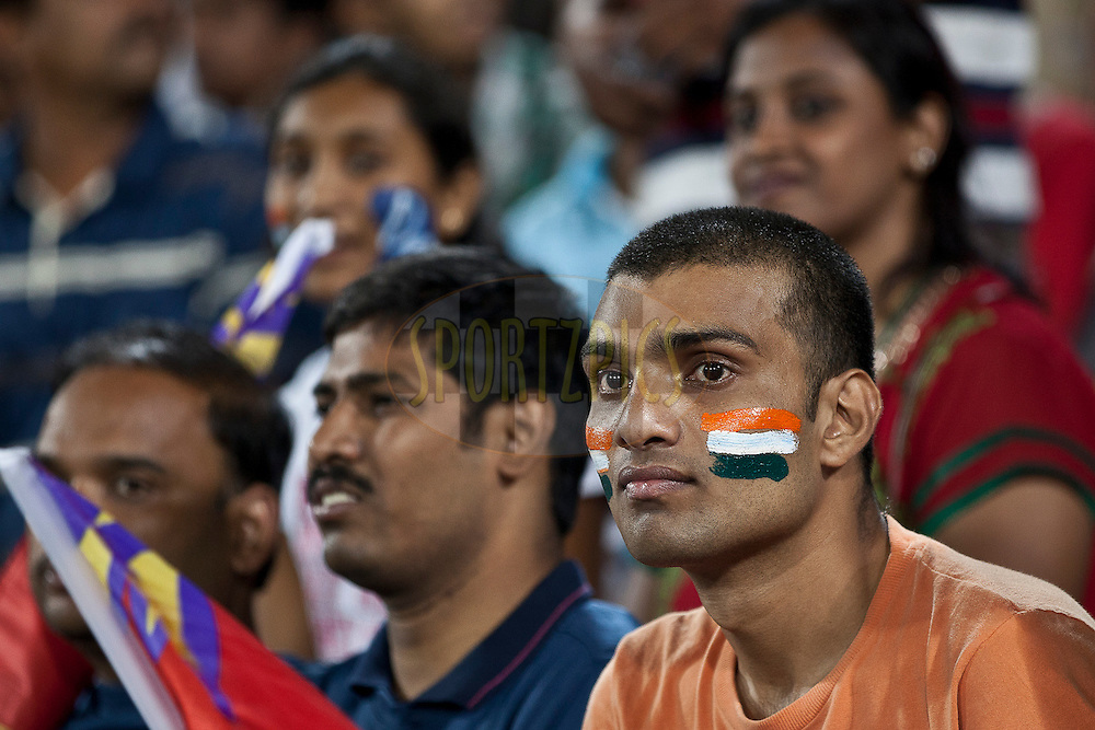 Fans with india flag at their face during match 11 of the Indian Premier League ( IPL ) between the Deccan Chargers and the Royal Challengers Bangalore held at the Rajiv Gandhi International Cricket Stadium in Hyderabad on the 14th April 2011..Photo by Saikat Das/BCCI/SPORTZPICS