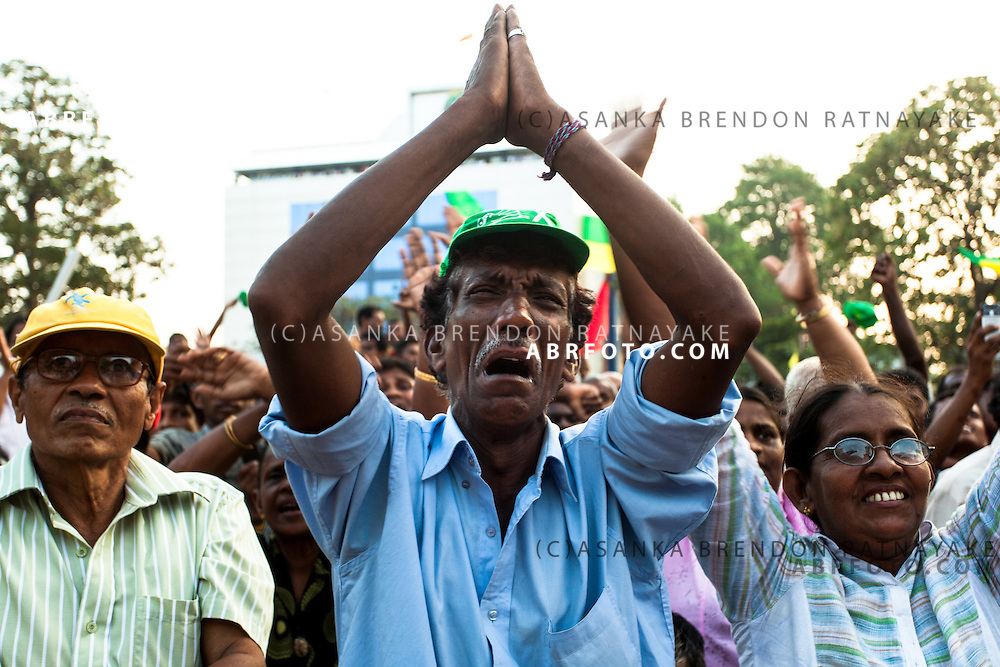 A supporter of Sarath Fonseka gets emotional during a Democratic National Alliance protest led by Sarath Fonseka after losing the 2010 Sri Lankan Presidential Election in COlombo Sri Lanka