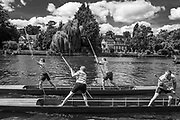 "Maidenhead, United Kingdom.  Two mixed doubles, competing at the  ""Thames Punting Club Regatta"", Bray Reach.<br />