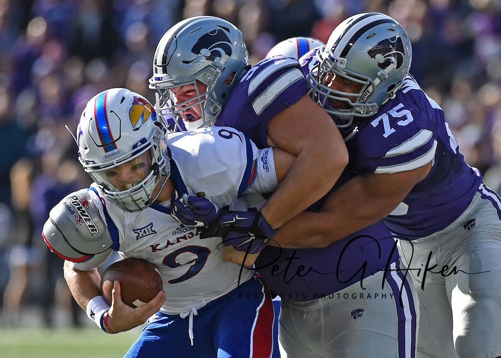 Defenders Jordan Willis #75 and Trey Dishon #99 of the Kansas State Wildcats sack quarterback Carter Stanley #9 of the Kansas Jayhawks during the first half at Bill Snyder Family Stadium in Manhattan, Kansas.