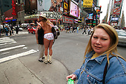 Naked cowboy giving hugs at Times square in New York.