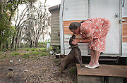 Sandy greets her dog after being away all day on Easter. A native Floridian, Sandy has worked in many industries throughout her life including her current one as a nurse assistant.