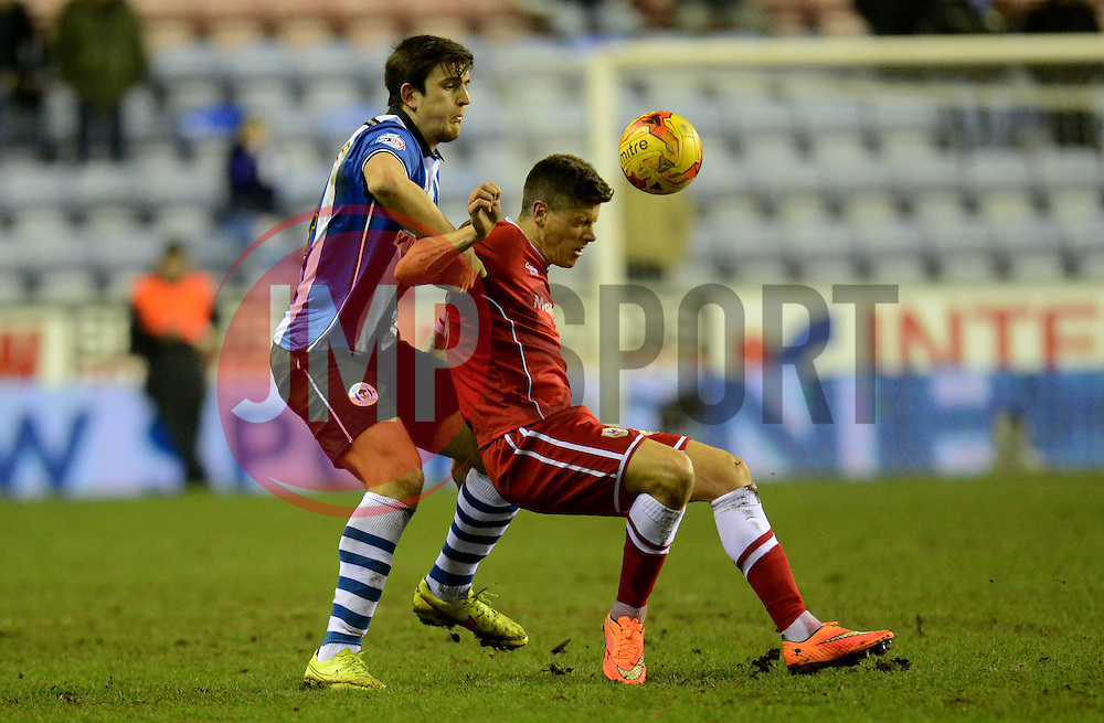 Wigan Athletic's Harry Maguire competes with Cardiff City's Alex Revell - Photo mandatory by-line: Richard Martin-Roberts/JMP - Mobile: 07966 386802 - 24/02/2015 - SPORT - Football - Wigan - DW Stadium - Wigan Athletic v Cardiff City - Sky Bet Championship