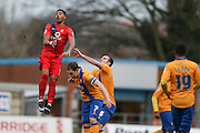 York City forward Vadaine Oliver  climbs highest during the Sky Bet League 2 match between Mansfield Town and York City at the One Call Stadium, Mansfield, England on 28 December 2015. Photo by Simon Davies.