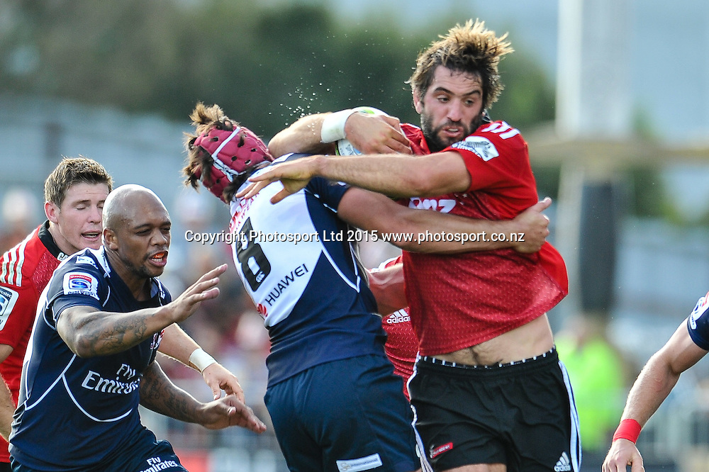 Sam Whitelock of the Crusaders fends off Warren Whiteley of the Lions  during the Super Rugby match: Crusaders v Lions at AMI Stadium, Christchurch, New Zealand, 14 March 2015. Copyright Photo: John Davidson / www.Photosport.co.nz