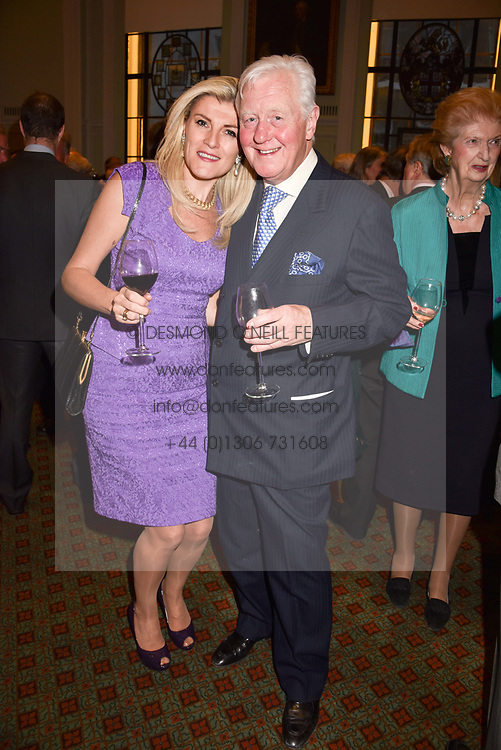 Sir Benjamin Slade and Bridget Convey at a party to celebrate the publication of Resolution by The Duke of Rutland and Emma Ellis held at Trinity House, Tower Hill, London England. 10 April 2017.