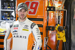 October 19, 2018 - Kansas City, Kansas, United States of America - Daniel Suarez (19) hangs out in the garage during practice for the Hollywood Casino 400 at Kansas Speedway in Kansas City, Kansas. (Credit Image: © Justin R. Noe Asp Inc/ASP via ZUMA Wire)