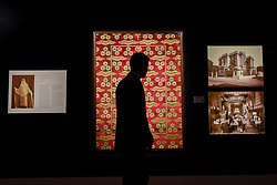 © Licensed to London News Pictures. 21/04/2017. London, UK.  A visitor is seen in silhouette against a large and exceptional Ottoman voided silk velvet and metal-thread panel (çatma) with çintamani and tiger-stripe design, Turkey, late 16th, early 17 century (est. GBP200-300k), at a preview at Sotheby's, New Bond Street, of upcoming sales of Arts of the Islamic World, 20th century Middle East Art and Orientalist art. Photo credit : Stephen Chung/LNP