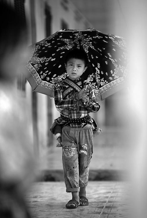 Flower Hmong boy at school in a village in Bac Ha, Vietnam.