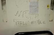 Roma 7 Febbraio  2014<br /> Il Centro di identificazione ed espulsione (CIE), per immigrati di Ponte Galeria a Roma.<br /> In una stanza su un muro   la scritta: Italia merda<br />   Center for Identification and Expulsion (CIE) for immigrants from Ponte Galeria in Rome. In a room on a wall that read: Italian shit