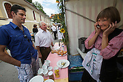 Kärntnernudelfest (Carinthian Dumplings Festival) in Oberdrauburg 2011. Marlies Mayer, co-organizer of the festival (with white apron).