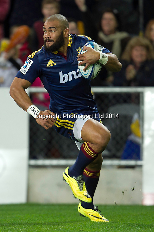 Patrick Osbourne of the Highlanders makes a break during the Super Rugby game between The Chiefs and The Highlanders, Forsyth Barr Stadium, Dunedin. 27 June 2014. Photo: Teaukura Moetaua/www.photosport.co.nz