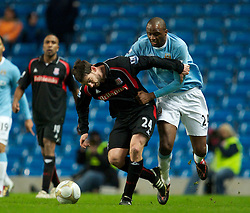 MANCHESTER, ENGLAND - Sunday, February 13, 2010: Manchester City's Patrick Vieira in action against Stoke City's Rory Delap during the FA Cup 5th Round match at the City of Manchester Stadium. (Photo by David Rawcliffe/Propaganda)  MANCHESTER, ENGLAND - Sunday, February 13, 2010: Manchester City xxxx and Stoke City's xxxx during the FA Cup 5th Round match at the City of Manchester Stadium. (Photo by David Rawcliffe/Propaganda)