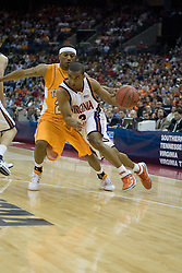 Virginia Cavaliers guard J.R. Reynolds (2) dribbles around Tennessee Volunteers guard Josh Tabb (25).  The #4 seed Virginia Cavaliers were defeated by the #5 seed Tennessee Volunteers 77-74 in the second round of the Men's NCAA Tournament in Columbus, OH on March 18, 2007.