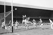 Cork's full forward B. Cummins punches the ball across the bar as the Sligo defenders look on helplessly during the All Ireland Minor Gaelic Football Final Sligo v. Cork in Croke Park on the 22nd September 1968. Cork 3-5, Sligo 1-10.