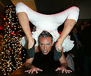 """NEW YORK - DECEMBER 10: Performer """"Acroback"""" at the  2nd annual toy drive to benefit the Children's Hope Foundation for HIV positive children and teens at the David Barton Gym, December 10 2002 in New York City.   (Photo by Matthew Peyton)"""