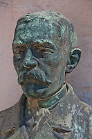 Copper bust of a man on a grave in Isola San Michel, Venice, Italy.