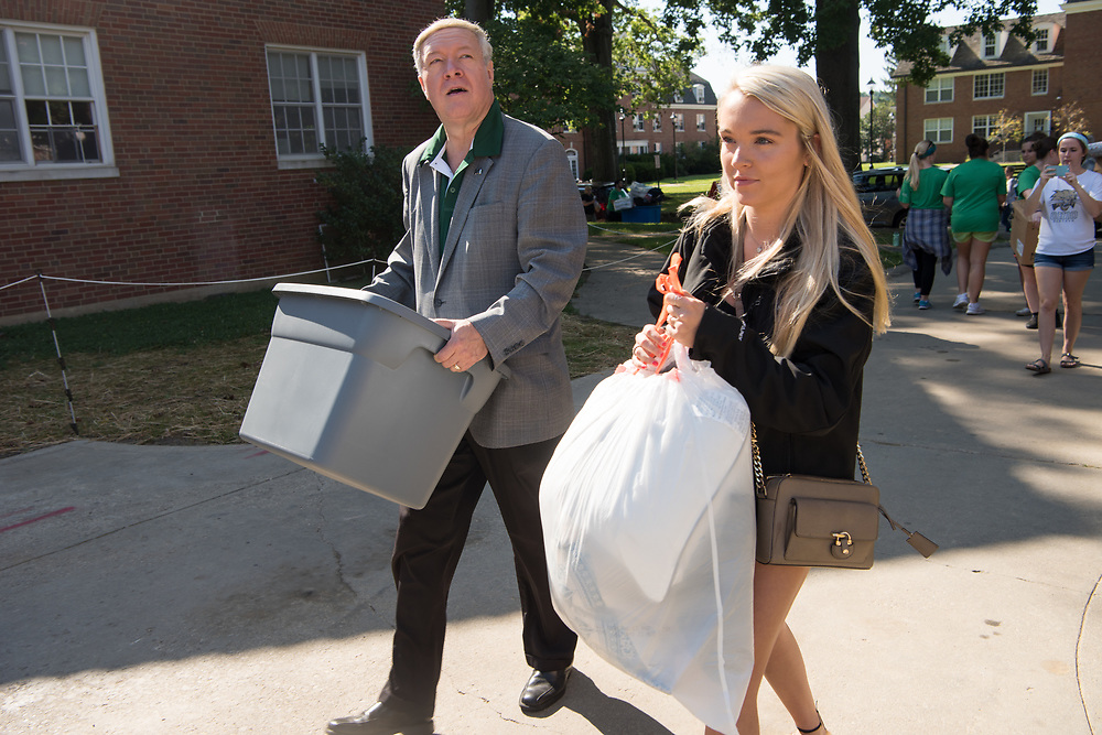 President Nellis helps first year student Mackenzie Embrey move into her residence hall on East Green Thursday morning. Photo by Ben Siegel