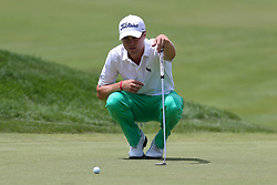 June 22, 2018 - Cromwell, Connecticut, United States - Justin Thomas lines up a putt on the 9th green during the second round of the Travelers Championship at TPC River Highlands. (Credit Image: © Debby Wong via ZUMA Wire)