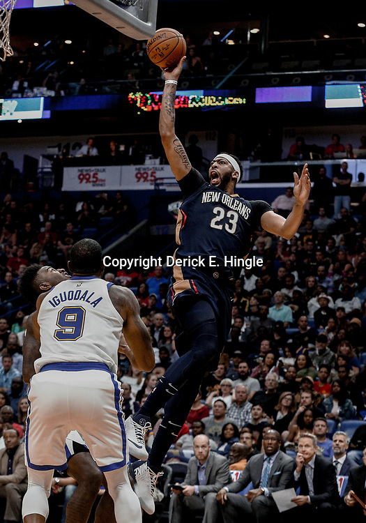 Oct 20, 2017; New Orleans, LA, USA; New Orleans Pelicans forward Anthony Davis (23) shoots over Golden State Warriors forward Andre Iguodala (9) during the second half of a game at the Smoothie King Center. The Warriors defeated the Pelicans 128-120.  Mandatory Credit: Derick E. Hingle-USA TODAY Sports