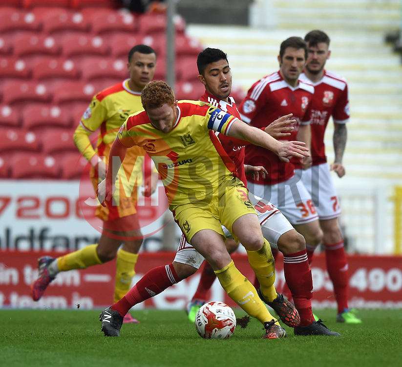 Milton Keynes Dons captain Dean Lewington in action during the Sky Bet League One match between Swindon Town and Milton Keynes Dons at The County Ground on 4 April 2015 in Swindon, England - Photo mandatory by-line: Paul Knight/JMP - Mobile: 07966 386802 - 04/04/2015 - SPORT - Football - Swindon - The County Ground - Swindon Town v Milton Keynes Dons - Sky Bet League One