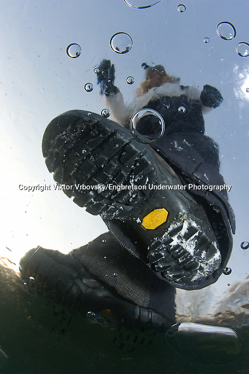 Person Standing On Clear, Lake Ice<br /> <br /> Viktor Vrbovsky/Engbretson Underwater Photography