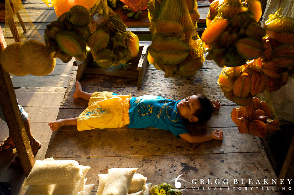 A young boy rests in the Market in Leticia - Amazonas - Colombia