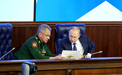 January 30, 2018 - Moscow, Russia - January 30, 2018. - Russia, Moscow. - Russian President Vladimir Putin at a military and practical conference following the special operation in Syria at Russia's National Defense Control Center. Left: Russian Defense Minister Sergey Shoigu. (Credit Image: © Russian Look via ZUMA Wire)
