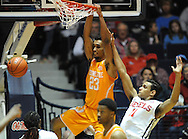 "Tennessee Volunteers forward Derek Reese (23) dunks against Mississippi Rebels forward Sebastian Saiz (11) at the C.M. ""Tad"" Smith Coliseum in Oxford, Miss. on Saturday, February 21, 2015. (AP Photo/Oxford Eagle, Bruce Newman)"