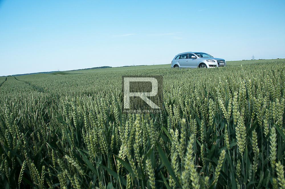 Audi Q7 in a field of wheat near Ingolstadt, Germany.