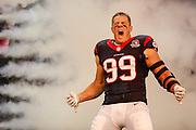 Oct 14, 2012; Houston, TX, USA; Houston Texans defensive end J.J. Watt (99) runs on the field against the Green Bay Packers during the first quarter at Reliant Stadium. The Packers won 42-24. Mandatory Credit: Thomas Campbell-thomasgcampbell.com