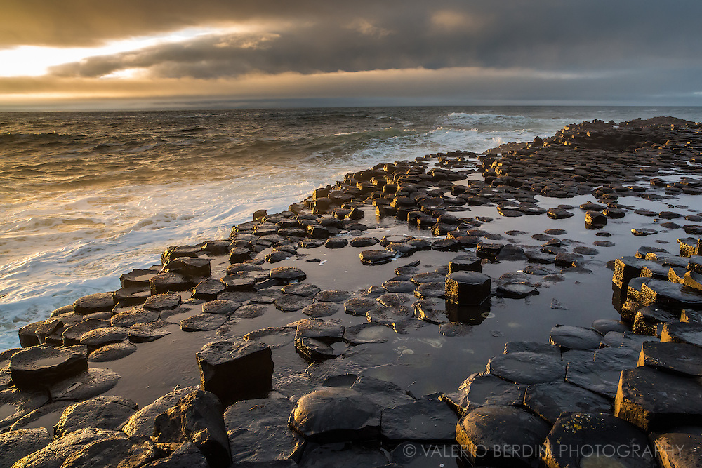 The sun managed to pierce the clouds for less then a minute just before sunset. The basalt formation of the Giant's Causeway turned golden.
