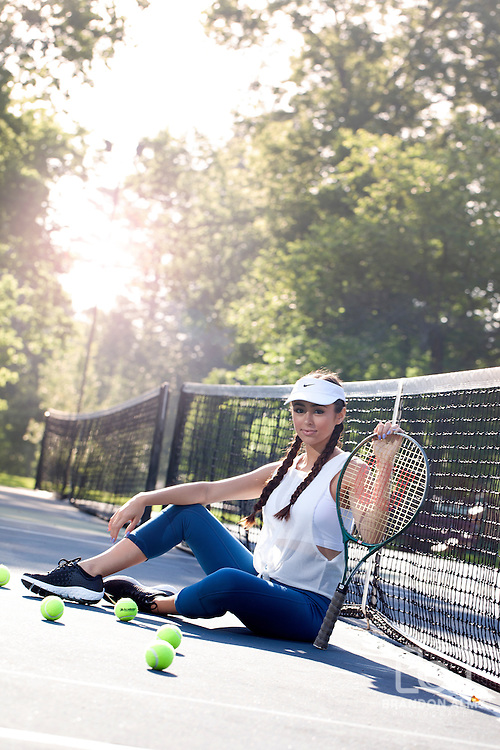 Athletic Teenage Tennis Player on the courts.