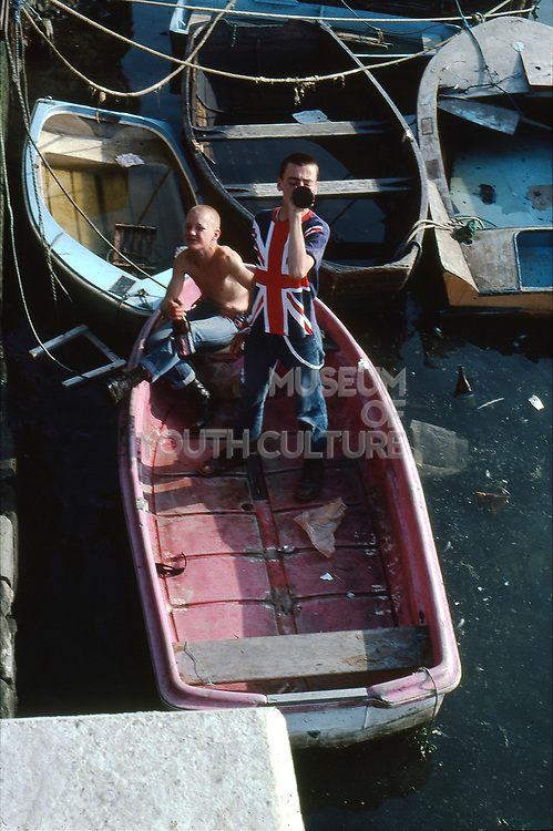 Lee and Symond on a boat in Dorset, UK, 1980s.