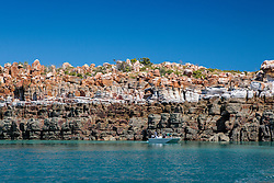 Passengers from a Kimberley charter boat view the unique geological formations around Wailgwin Island in Camden Sound.