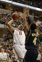 Ohio State forward Jared Sullinger (0) goes up to the basket against Michigan forward Evan Smotrycz (23) and guard Darius Morris (4) in the first half of the Big Ten Tournament semifinals in Indianapolis, on March, 11, 2011, at Conseco Fieldhouse. Ohio State defeated Michigan 68-61.