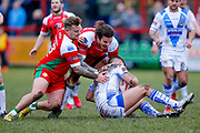 Keighley Cougars loose forward Mike Emmett (13) and Keighley Cougars prop Samir Tahraoui (27) tackle Workington Town full back Jamie Foster (1)  during the Betfred League 1 match between Keighley Cougars and Workington Town at Cougar Park, Keighley, United Kingdom on 18 February 2018. Picture by Simon Davies.